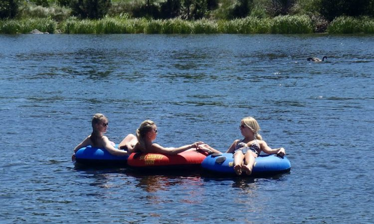 girls floating the deschutes river in sunriver